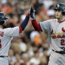 St. Louis Cardinals' David Freese (23) is congratulated by Daniel Descalso (33) after Freese hit a two-run home run during the second inning of Game 1 of baseball's National League championship series against the San Francisco Giants Sunday, Oct. 14, 2012, in San Francisco. (AP Photo/David J. Phillip)