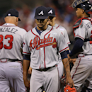 Atlanta Braves starting pitcher Ervin Santana, center, comes off the mound after giving up three runs in the sixth inning of a baseball game against the Philadelphia Phillies, Friday, Sept. 26, 2014, in Philadelphia. The Phillies won 5-4. (AP Photo/Laurence Kesterson)