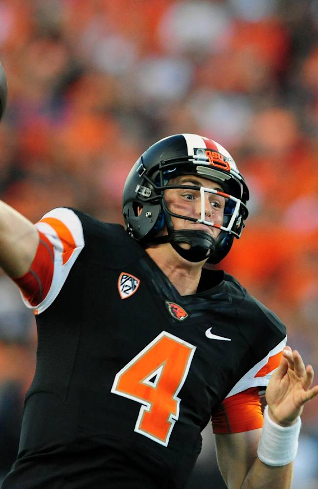 In this Sept. 7, 2013, file photo, Oregon State quarterback Sean Mannion (4) throws a touchdown pass in the third quarter of an NCAA college football game against Hawaii in Corvallis, Ore. On Saturday, Utah hosts Oregon State, a team that has struggled to find its offense after the first two games of the season