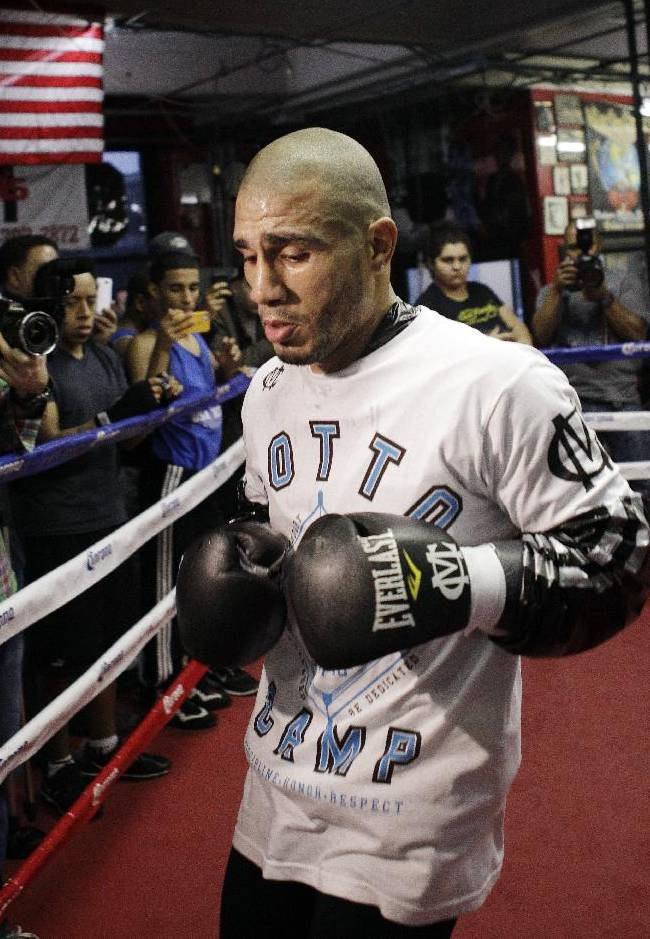 In this Nov. 27, 2012, file photo, Miguel Cotto, of Puerto Rico, cools down after a boxing workout at Gleason's Gym in the Brooklyn borough of New York. Cotto returns from a 10-month absence in the ring on Saturday, Oct. 5, 2013, in Orlando, Fla., when he takes on  Delvin Rodriguez in a 12-round junior middleweight fight