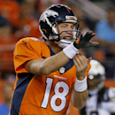 Denver Broncos quarterback Peyton Manning calls a play against the San Diego Chargers during the first half of an NFL football game, Thursday, Oct. 23, 2014, in Denver. (AP Photo/Jack Dempsey)