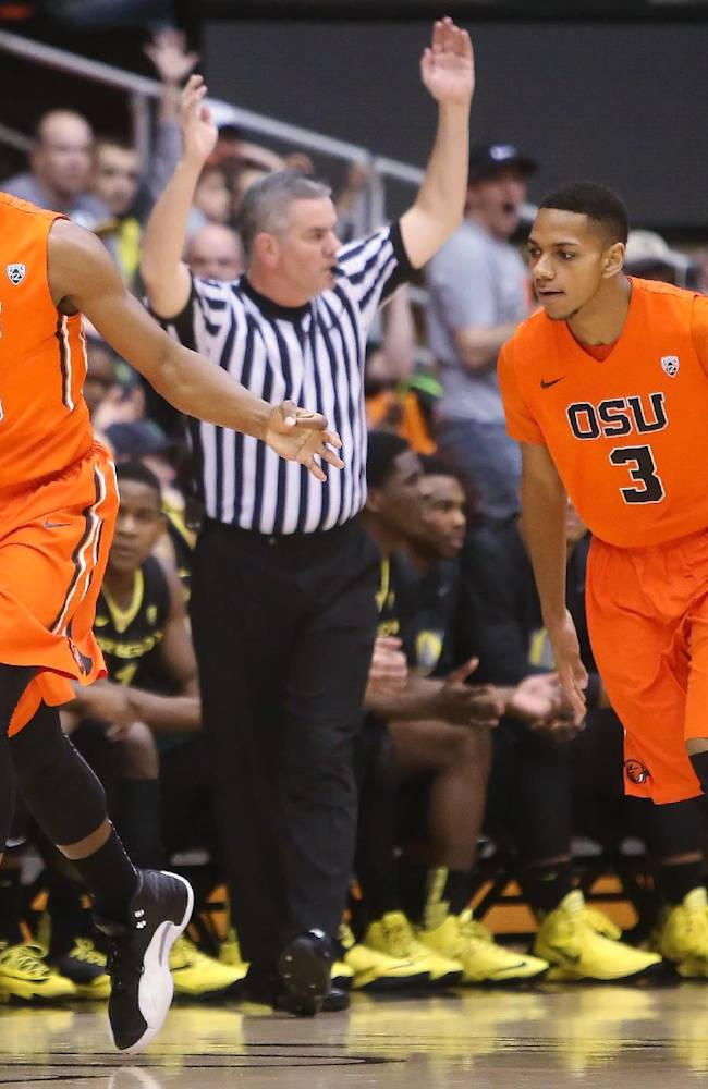 Oregon State's Langs Morris-Walker (13) celebrates a three-pointer with teammate Hallice Cooke (3) during an NCAA men's basketball game at Gill Coliseum in Corvallis, Ore. on Sunday, Jan. 19, 2014. Oregon lost 80-72 to Oregon State