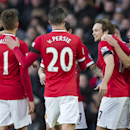 Manchester United's Daley Blind, center right, celebrates with teammates after forcing a Leicester own goal during the English Premier League soccer match between Manchester United and Leicester at Old Trafford Stadium, Manchester, England, Saturday Jan.