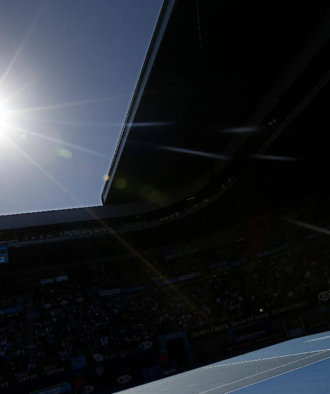 Britain's Andy Murray makes a backhand return to Lithuania's Ricardas Berankis during their third round match at the Australian Open tennis championship in Melbourne, Australia, Saturday, Jan. 19, 2013