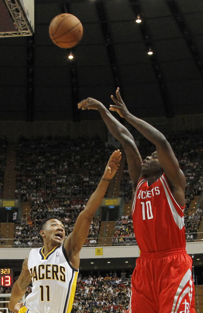NBA Houston Rockets Ronnie Brewer (10) takes a jump shot over Indiana Pacers Orlando Johnson (11) during a preseason game in Taipei, Taiwan, Sunday, Oct. 13, 2013. The Rockets beat the Pacers 107-98