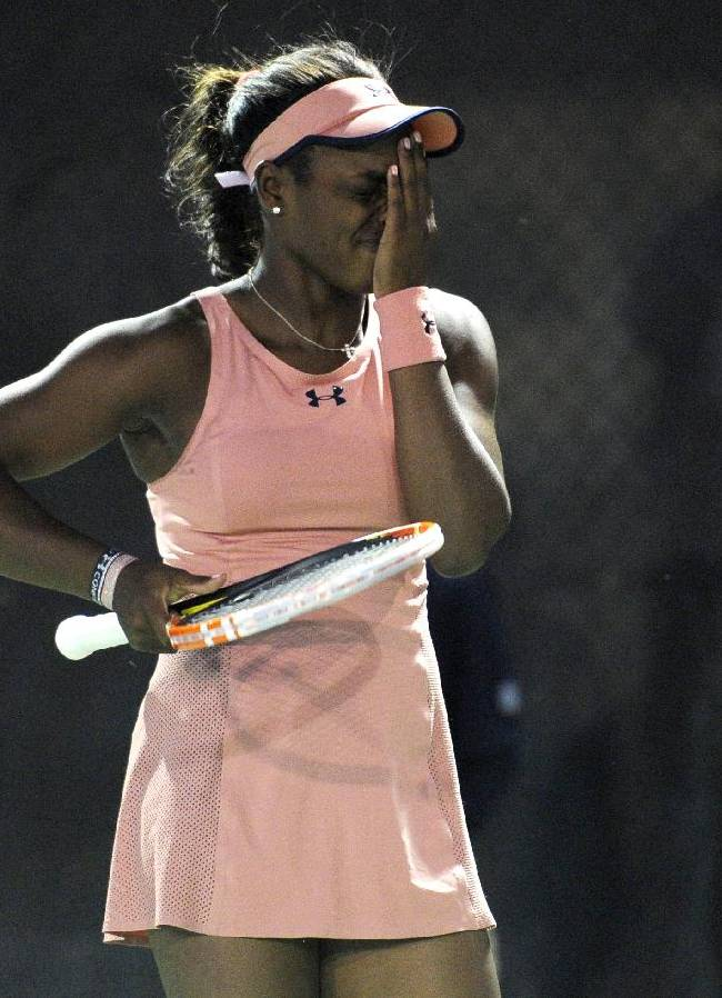 Sloane Stephens reacts during a match against Christina McHale at the Citi Open tennis tournament, Tuesday, July 29, 2014, in Washington