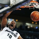 Providence's Kadeem Batts (10) dunks in the first half of an NCAA college basketball game against Notre Dame in Providence, R.I., Saturday, Feb. 16, 2013. (AP Photo/Michael Dwyer)