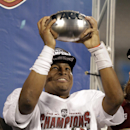 Florida State's Jameis Winston holds up the trophy after the Atlantic Coast Conference Championship NCAA football game in Charlotte, N.C., Saturday, Dec. 7, 2013. Florida State defeated Duke 45-7. (AP Photo/Bob Leverone)