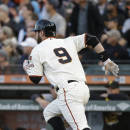 San Francisco Giants' Brandon Belt runs toward first base after hitting a two RBI double to right field against Pittsburgh Pirates starting pitcher Gerrit Cole in the first inning of their baseball game Monday, June 1, 2015, in San Francisco. (AP Photo/Eric Risberg)