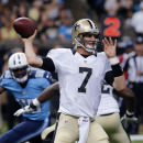 New Orleans Saints quarterback Luke McCown (7) passes under pressure in the first half of an NFL football game against the Tennessee Titans in New Orleans, Friday, Aug. 15, 2014 The Associated Press