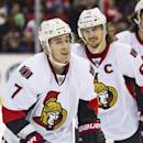 Ottawa Senators forward Kyle Turris (7) skates near defenseman Erik Karlsson, of Sweden, after Turris scored a goal during the first period of an NHL hockey game against the Detroit Red Wings in Detroit, Mich., Monday, Nov. 24, 2014. (AP Photo/Tony Ding)