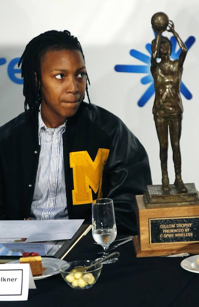Southern Mississippi guard Jamierra Faulkner looks at her Gillom Trophy during award ceremonies on Monday afternoon, March 3, 2014 at the Mississippi Sports Hall of Fame in Jackson, Miss.  The award sponsored by C Spire Wireless, is given to Mississippi's best women's college basketball player