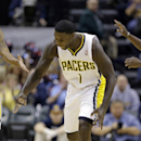 Indiana Pacers guard Lance Stephenson reacts to hitting a three-point basket against the Memphis Grizzlies in the first half of an NBA basketball game in Indianapolis, Monday, Nov. 11, 2013. The Pacers defeated the Grizzlies 95-79. Stephenson had his fi