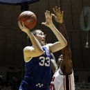 Kentucky forward Kyle Wiltjer (33) scores on a shot past Mississippi forward Murphy Holloway (31) during the second half of their NCAA college basketball game, Tuesday, Jan. 29, 2013, in Oxford, Miss. Kentucky won 87-74. (AP Photo/Rogelio V. Solis)