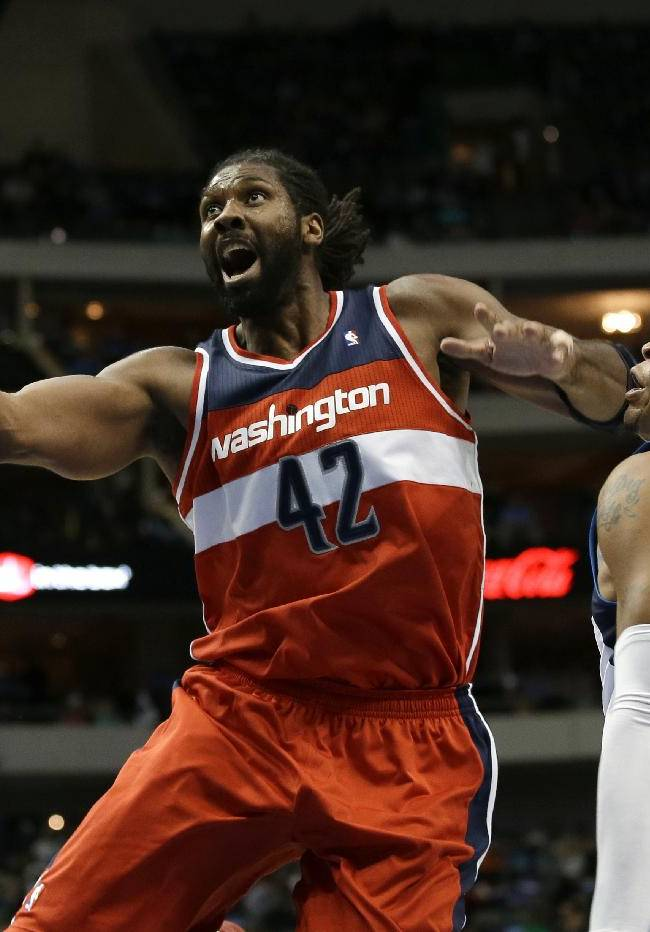 Washington Wizards' Nene Hilario (42), of Brazil, lands an elbow to the face of Dallas Mavericks' Shawn Marion (0) on a shot attempt in the first half of an NBA basketball game, Tuesday, Nov. 12, 2013, in Dallas