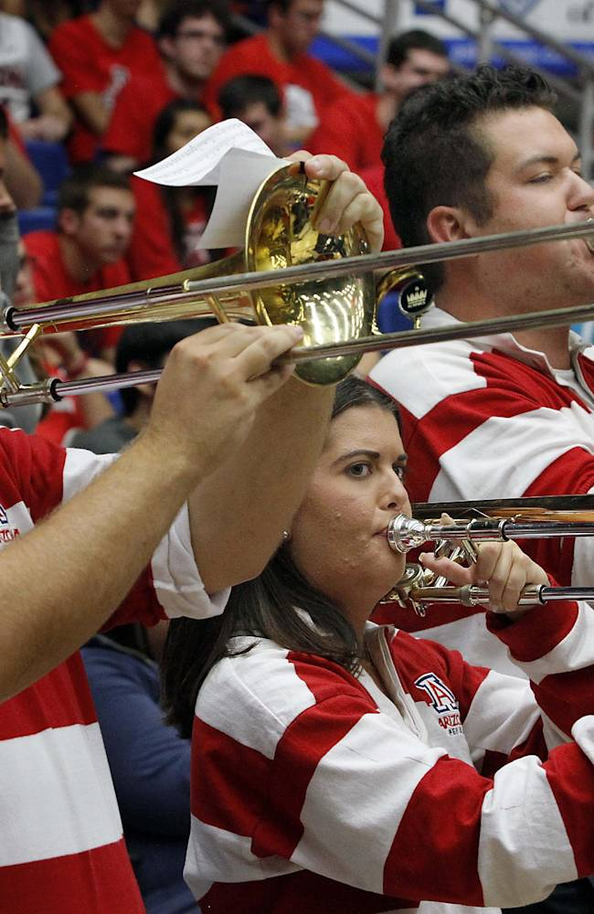 Jared Judy, far left, plays with Arizona's pep band before the start of the game against Rhode Island in an college NCAA basketball game, Tuesday, Nov. 19, 2013 in Tucson, Ariz. This is in the second round of the NIT