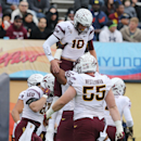 Arizona State quarterback Taylor Kelly was hoisted by teammates after scoring during the first quarter of the Sun Bowl NCAA college football game against Duke, Saturday, Dec. 27, 2014, in El Paso, Texas. (AP Photo/Victor Calzada)
