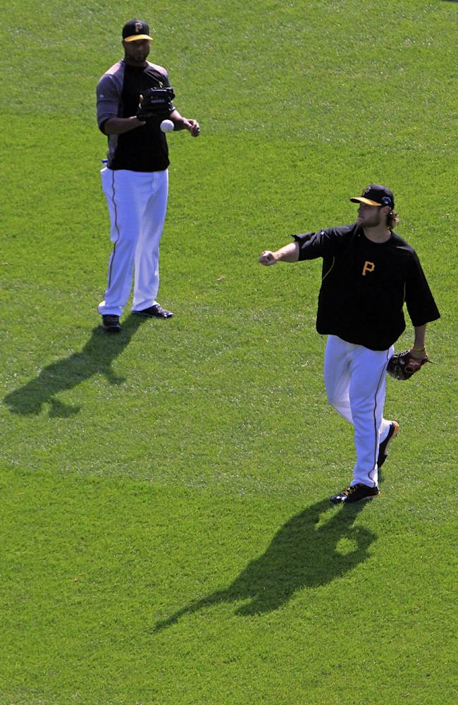 Pittsburgh Pirates pitchers Garrett Cole, right, and Francisco Liriano warm up before Game 4 of a National League division baseball series against the St. Louis Cardinals on Monday, Oct. 7, 2013, in  Pittsburgh