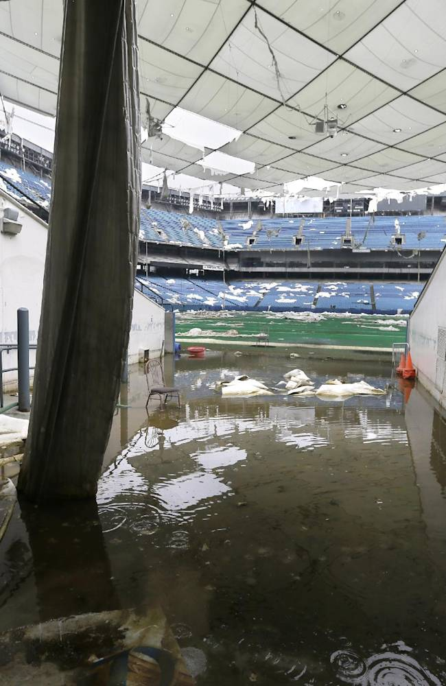 In this May 12, 2014 photo, the player's tunnel to the Pontiac Silverdome is seen in Pontiac, Mich. The Silverdome's current owner is determined to cash in before it's too late, putting everything inside up for auction starting on Wednesday, May 21