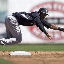 New York Yankees shortstop Eduardo Nunez dives unsuccessfully for a single hit by Toronto Blue Jays' Ryan Goins during third-inning spring exhibition baseball game action in Dunedin, Fla., Sunday, March 2, 2014 The Associated Press