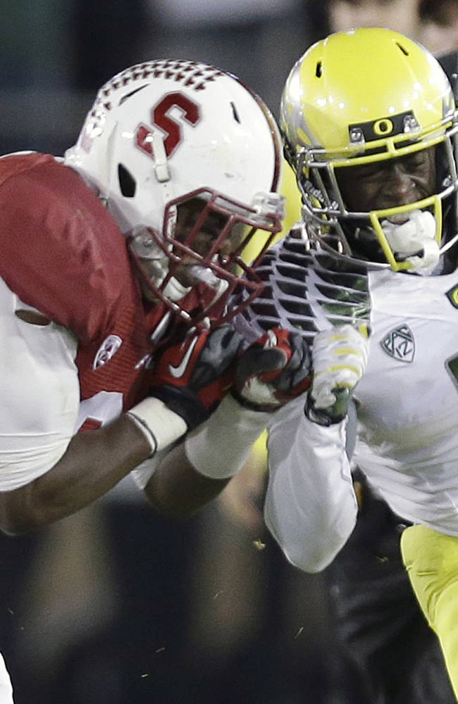 namStanford safety Jordan Richards, left, pushes Oregon running back De'Anthony Thomas (6) out of bounds during the second quarter of an NCAA college football game in Stanford, Calif., Thursday, Nov. 7, 2013