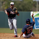 Atlanta Braves second baseman Tommy La Stella throws to first after forcing out Houston Astros' Jose Altuve (27), completing a double play during the third inning of a spring exhibition baseball game, Sunday, March 2, 2014, in Kissimmee, Fla. The Astros w