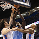 Denver Nuggets forward Kenneth Faried, center, loses the ball while defended by Oklahoma City Thunder forward Nick Collison (4) and guard Derek Fisher in the first quarter of an NBA basketball game in Oklahoma City, Monday, March 24, 2014 The Associated