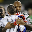 New York Red Bulls forward Thierry Henry hugs MLS All-Stars coach Caleb Porter after the All-Stars defeated Bayern Munich 2-1, Wednesday, Aug. 6, 2014, in Portland, Ore The Associated Press
