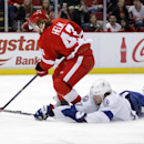 Tampa Bay Lightning's Victor Hedman (77), of Sweden, knocks the puck away as Detroit Red Wings' Darren Helm (43) skates toward the goal during the second period of an NHL hockey game on Sunday, March 30, 2014, in Detroit The Associated Press