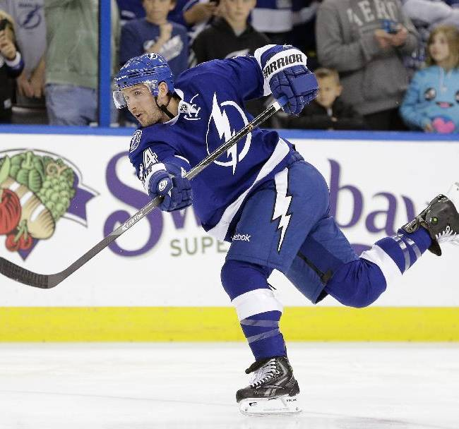 FILe - In this March 27, 2014 file photo, Tampa Bay Lightning forward Ryan Callahan (24) warms up before an NHL hockey game against the New York Islanders in Tampa, Fla. The Lightning have signed Callahan to a six-year contract. The team announced the move on Wednesday, June 25, 2014