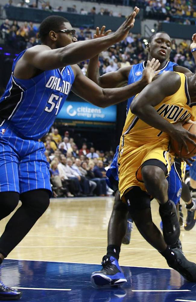 Indiana Pacers guard Lance Stephenson, right, reacts sd Orlando Magic center Jason Maxiell (54) and guard Victor Oladipo defend during the second half of an NBA basketball game in Indianapolis, Tuesday, Oct. 29, 2013. The Pacers won 97-87