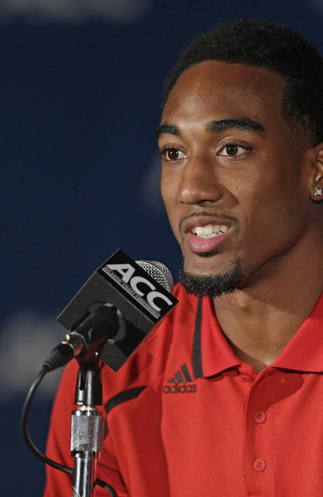 North Carolina State's Dontae Johnson speaks during the Atlantic Coast Conference Media Day in Greensboro, N.C., Sunday, July 21, 2013