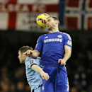 Chelsea's Branislav Ivanovic, right, vies for the ball with Manchester City's James Milner during the English Premier League soccer match between Chelsea and Manchester City at Stamford Bridge stadium in London, Saturday, Jan. 31, 2015