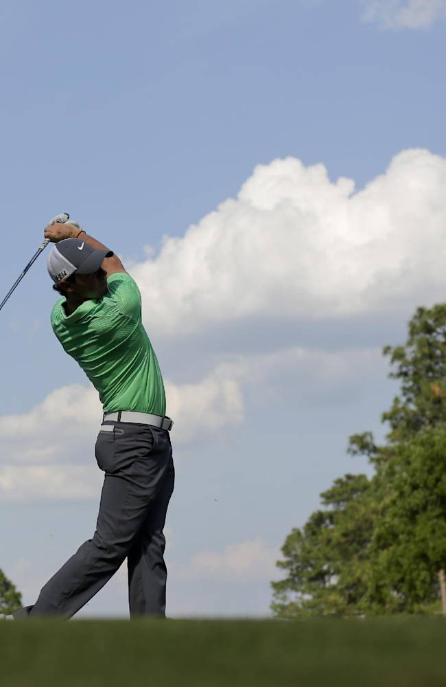 Rory McIlroy, of Northern Ireland, hits his tee shot on the seventh hole during a practice round for the U.S. Open golf tournament in Pinehurst, N.C., Tuesday, June 10, 2014. The tournament starts Thursday