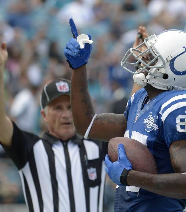 In this Sept. 29, 2013 file photo, Indianapolis Colts wide receiver Reggie Wayne (87) celebrates after catching a touchdown pass in the end zone during the first half of an NFL football game against the Jacksonville Jaguars in Jacksonville, Fla.The Colts have rallied round Wayne for years. Now, for the first time since became a major contributor, Indianapolis will find out what life is like without their talented receiver