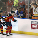 Florida Panthers' Nick Bjugstad (27) celebrates with Scottie Upshall (19) after Upshall scored the winning goal against the Arizona Coyotes during the third period of an NHL hockey game in Sunrise, Fla., Thursday, Oct. 30, 2014. The Panthers won 2-1 The A