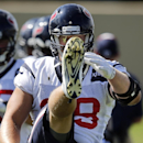Houston Texans defensive end J.J. Watt stretches during a joint practice between the Denver Broncos and the Texans on Thursday, Aug. 21, 2014, in Englewood, Colo The Associated Press