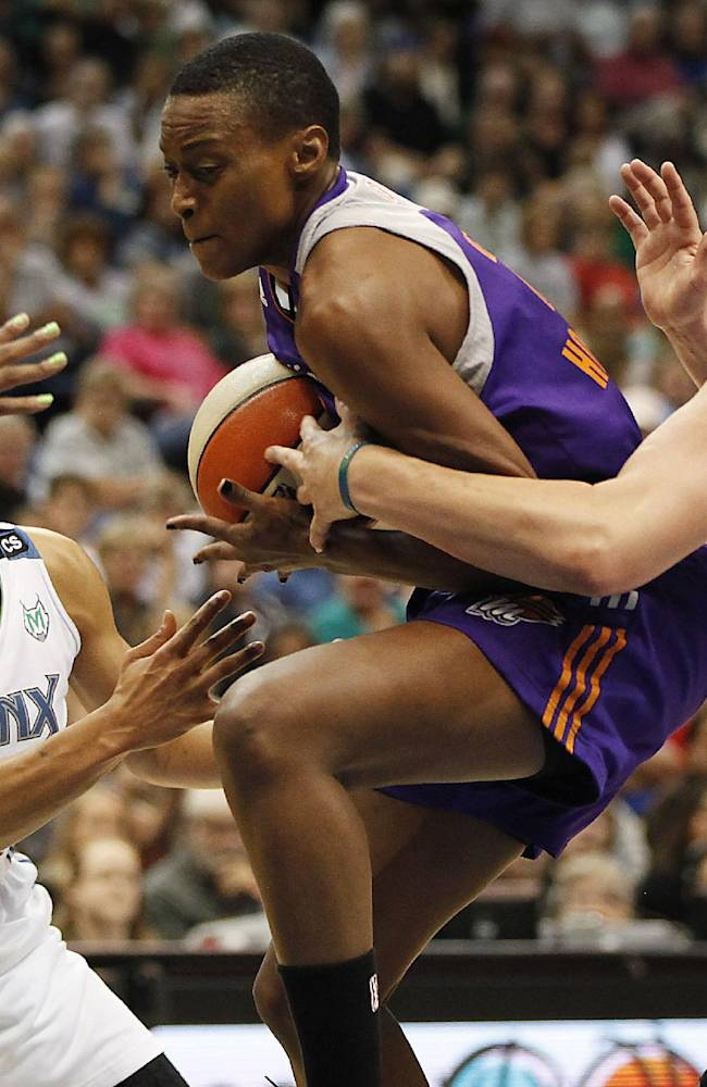 Phoenix Mercury forward Charde Houston, center, pushes the ball through the defense of Minnesota Lynx forward Maya Moore, left, and forward Janel McCarville, right, during Game 1 of the WNBA basketball playoffs Western Conference finals on Thursday, Sept. 26, 2013, in Minneapolis. The Lynx won 85-62