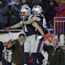New England Patriots wide receiver Danny Amendola, right, leaps to celebrate after catching a 51-yard touchdown pass from Julian Edelman, left, against the Baltimore in the second half of an NFL divisional playoff football game Saturday, Jan. 10, 2015, in