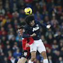 Manchester United s Marouane Fellaini, right, competes for the ball with Cardiff City s Craig Noone during the English Premier League soccer match between Manchester United and Cardiff City at Cardiff City Stadium in Cardiff, Wales, Sunday, Nov. 24, 2013