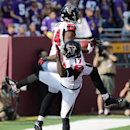 Atlanta Falcons wide receiver Roddy White (84) reacts with teammate Devin Hester (17) after catching a 24-yard touchdown pass during the first half of an NFL football game against the Minnesota Vikings, Sunday, Sept. 28, 2014, in Minneapolis. The Associat