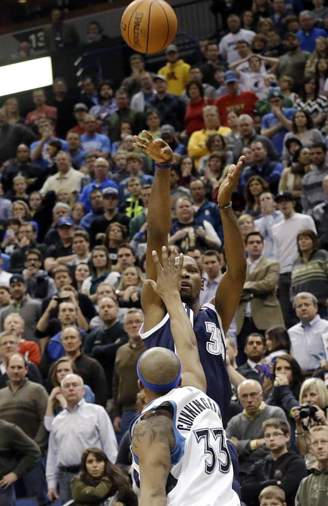 Oklahoma City Thunder's Kevin Durant shoots a successful field goal over Minnesota Timberwolves' Dante Cunningham with 4 seconds remaining in an NBA basketball game Saturday, Jan. 4, 2014, in Minneapolis. The Thunder won 115-111 with Durant scoring 48 points