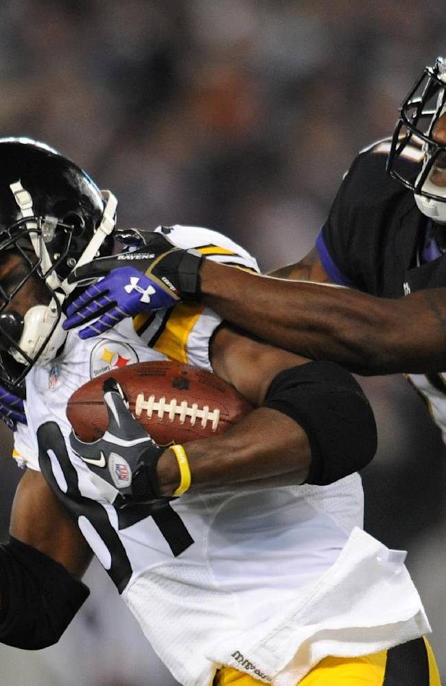 Pittsburgh Steelers wide receiver Antonio Brown, left, is tackled by Baltimore Ravens cornerback Lardarius Webb after getting a first down in the first half of an NFL football game on Thursday, Nov. 28, 2013, in Baltimore