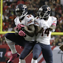 Chicago Bears wide receiver Josh Morgan (19)celebrates his touchdown with Chicago Bears wide receiver Santonio Holmes (14) during the first half of an NFL football game against the Atlanta Falcons, Sunday, Oct. 12, 2014, in Atlanta The Associated Press