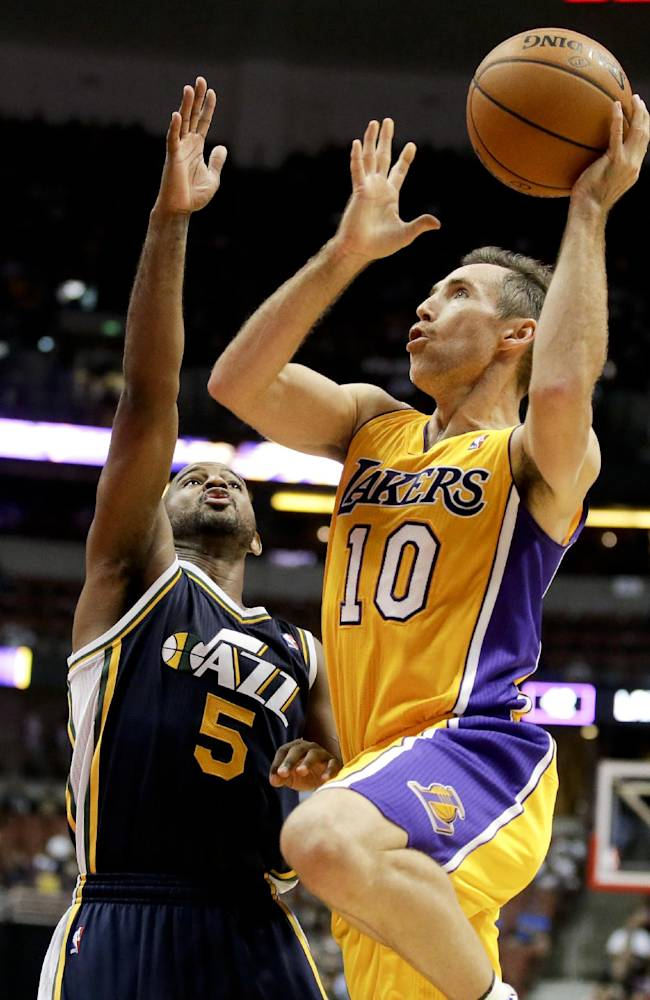 Los Angeles Lakers guard Steve Nash, right, shoots over Utah Jazz guard John Lucas III during the first half of a preseason NBA basketball game in Anaheim, Calif., Friday, Oct. 25, 2013