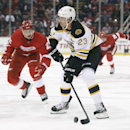 Boston Bruins center Chris Kelly (23) looks to shoot as Detroit Red Wings defenseman Brendan Smith (2) defends in the first period of a NHL hockey game in Detroit Thursday, Oct. 9, 2014 The Associated Press