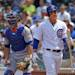 As New York Mets catcher Anthony Recker looks on, Chicago Cubs' Anthony Rizzo, right, reacts after striking out with two men on base in the first inning of a baseball game in Chicago on Sunday, May 19, 2013