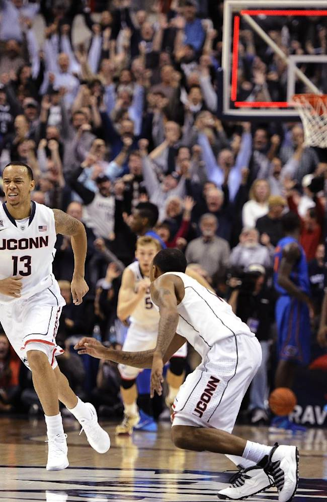 Connecticut's Shabazz Napier, left, and Ryan Boatright, right, react after Napier hits the game winning basket at the end an NCAA college basketball game against Florida, Monday, Dec. 2, 2013, in Storrs, Conn. Connecticut won 65-64