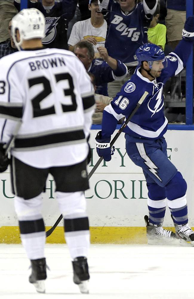 Tampa Bay Lightning right wing Teddy Purcell, right, celebrates by Los Angeles Kings right wing Dustin Brown after scoring a goal during the first period of an NHL hockey game Tuesday, Oct. 15, 2013, in Tampa, Fla