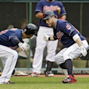 Cleveland Indians' Jason Kipnis, right, greets Nick Swisher after Swisher's solo home run against the New York Mets in the second inning of a baseball game Saturday, Sept. 7, 2013, in Cleveland. (AP Photo/Mark Duncan)